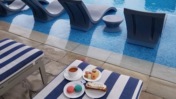 Afternoon Tea by the swimming pool at the Ritz Carlton Waikiki
